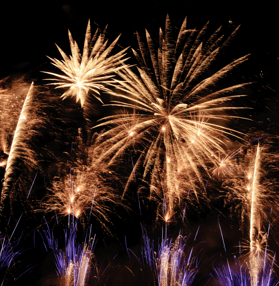 Fireworks extravaganza in reddish-yellow, white, and blue