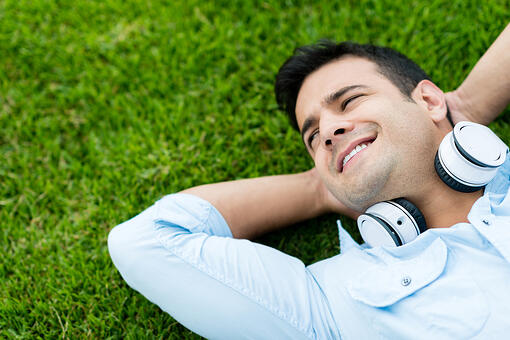 Portrait of a man relaxing outdoors with headphones