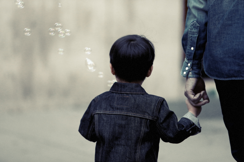 Child-holding-parents-hand.jpg